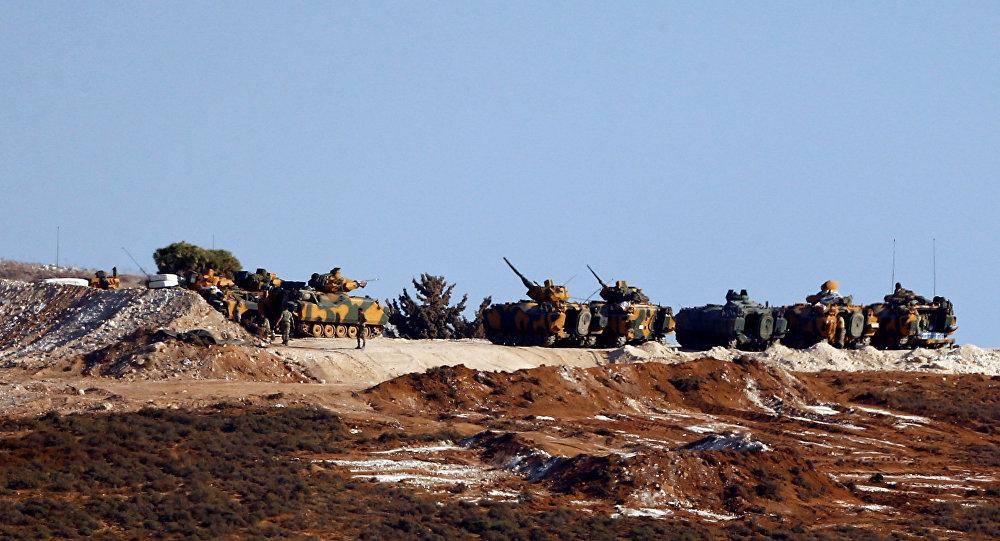 Turkish military vehicles are seen on the Turkish-Syrian border line in Reyhanli, Hatay province, Turkey, October 13, 2017