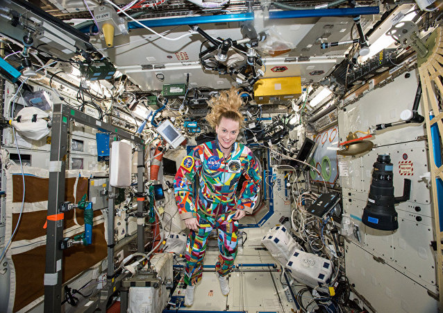 This undated handout photo from NASA shows astronaut Kate Rubins aboard the International Space Station wearing a hand-painted spacesuit decorated by childhood cancer patients at the University of Texas MD Anderson Cancer Center in Houston. NASA said Rubins will chat from the space station with patients during a 20-minute call on Friday, Sept. 16, 2016