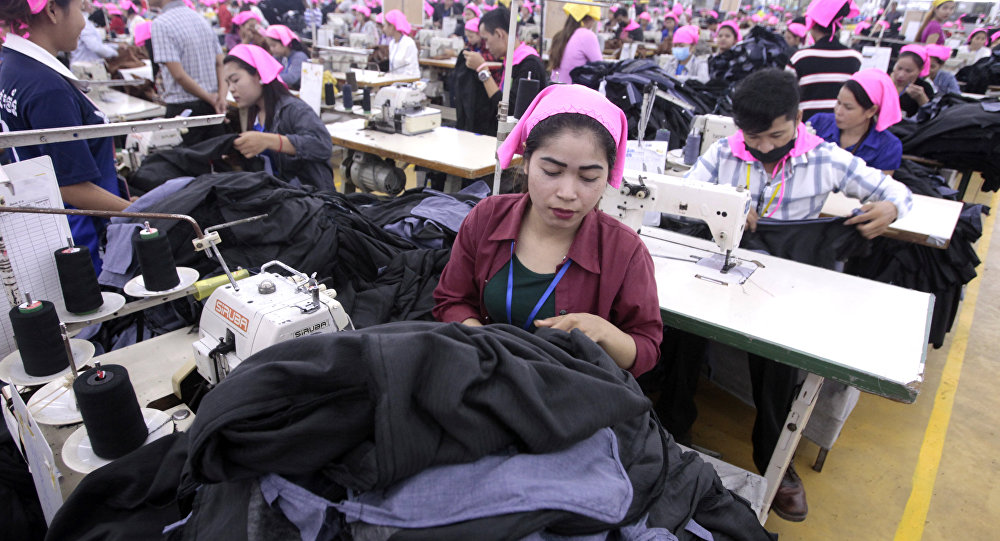 Cambodian garment workers sew clothes in a factory as they wait for visit by their Prime Minister Hun Sen at Phnom Penh Special Economic Zone in the outskirts of Phnom Penh, Cambodia, Wednesday, Aug. 23, 2017. Hun Sen on Wednesday began his plan to visit workers at factories in Cambodia.