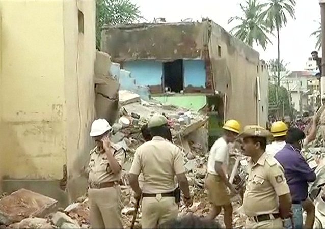 Rescue workers and police are seen at the site following a building collapse in Bengaluru, Karnataka, India in this still frame taken from video October 16, 2017