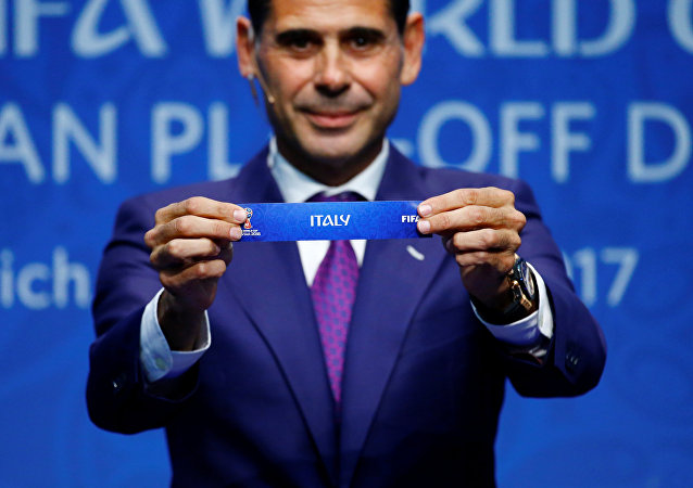 FIFA World Cup European Play-Off Draw - Zurich, Switzerland - October 17, 2017 Former Spanish player Fernando Hierro displays the name 'Italy' during the draw