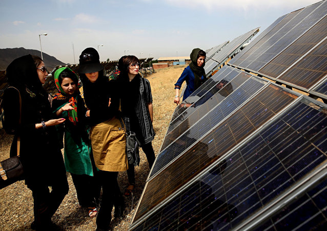 In this June, 22, 2014 photo, Iranian students tour the Taleghan Renewable Energy Site in Taleghan,160 kilometers (99 miles) northwest of capital Tehran, Iran