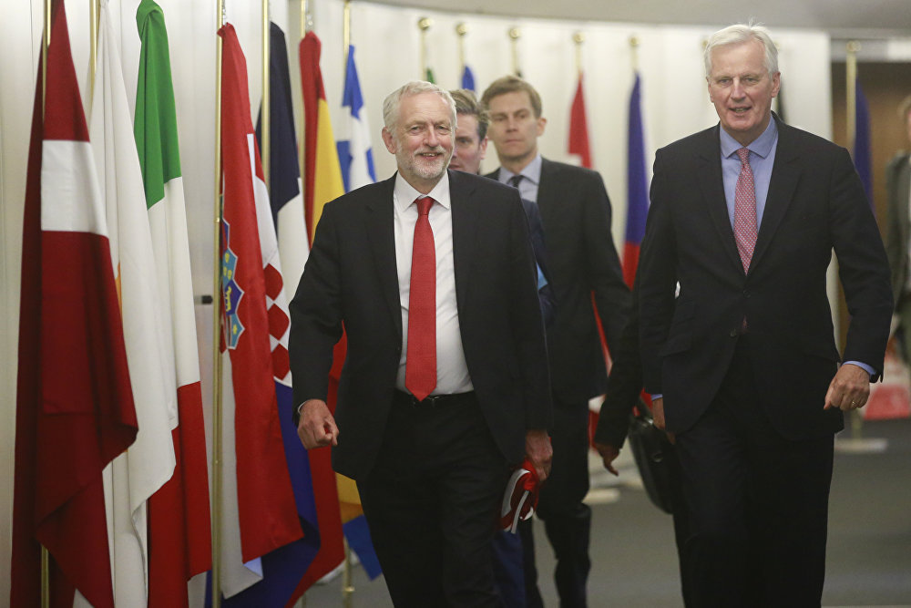 The EU chief Brexit negotiator Michel Barnier, right, welcomes British Labour Party leader Jeremy Corbyn for a meeting at EU headquarters in Brussels, Thursday July 13, 2017.