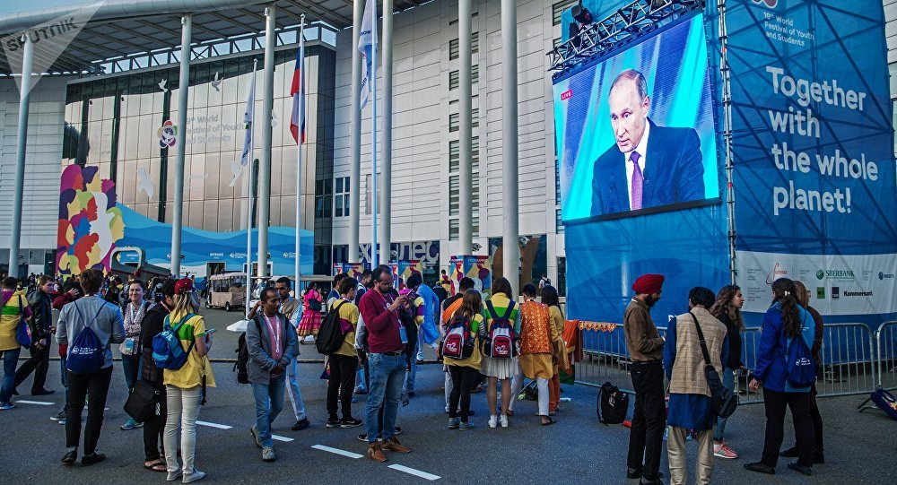 19th World Festival of Youth and Students participants watching the broadcast of President Vladimir Putin's speech at the final meeting of the Valdai International Discussion Club