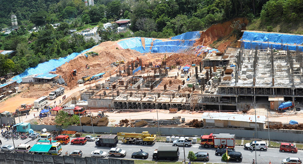 Rescue workers are seen at a construction site after it was hit by a landslide in Tanjung Bungah, Penang, Malaysia October 21, 2017