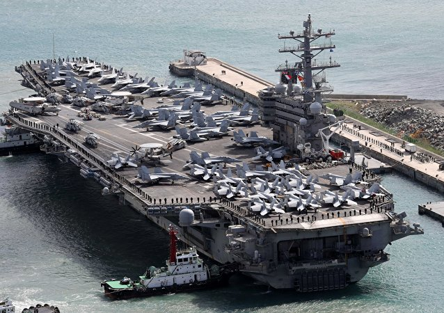 The USS Ronald Reagan aircraft carrier arrives in the South Korean port city of Busan on October 21, 2017