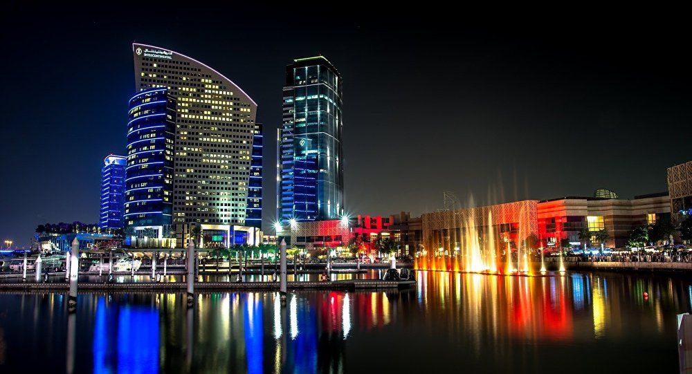 The city of Dubai next to lake at night-time, United Arab Emirates