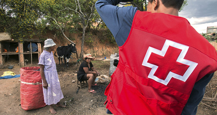 Red Cross volunteers speak to educating villagers about the plague outbreak, 30 miles west of Antananarivo, Madagascar, Monday, Oct. 16, 2017