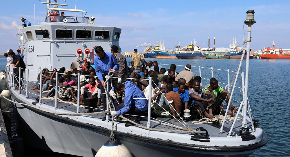 Migrants in a boat arrive at a naval base after they were rescued by Libyan coastguard, in Tripoli, Libya, October 17, 2017
