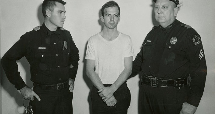 Lee Harvey Oswald, accused of assassinating former U.S. President John F. Kennedy, is pictured with Dallas police Sgt. Warren (R) and a fellow officer in Dallas, in this handout image taken on November 22, 1963.