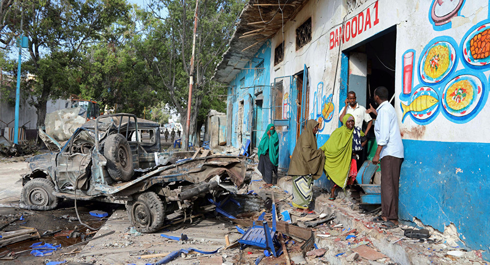 Residents gather at the scene of a suicide car bomb explosion, at the gate of Naso Hablod Two Hotel in Hamarweyne district of Mogadishu, Somalia October 29, 2017