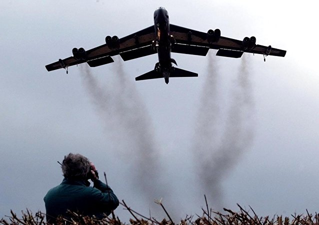 March 3, 2002 file photo shows a member of the public watching a US Air Force B 52 bomber arriving at RAF Fairford in western England. Pushing his vision of a nuclear weapons-free world, President Barack Obama returned to Prague on Thursday, April 8, 2010 to sign a pivotal treaty aimed at sharply paring U.S. and Russian arsenals — and repairing soured relations between the nations. With that, they will commit their nations to slash the number of strategic nuclear warheads by one-third and more than halve the number of missiles, submarines and bombers carrying them, pending ratification by their legislatures. The new treaty will shrink those warheads to 1,550 over seven years. That still allows for mutual destruction several times over. But it will send a strong signal that Russia and the U.S., which between them own more than 90 percent of the world's nuclear weapons, are serious about disarmament.