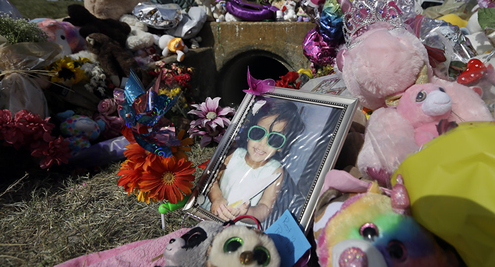 A photograph of 3-year-old Sherin Mathews sits by a makeshift memorial, Saturday, Oct. 28, 2017, in Richardson, Texas