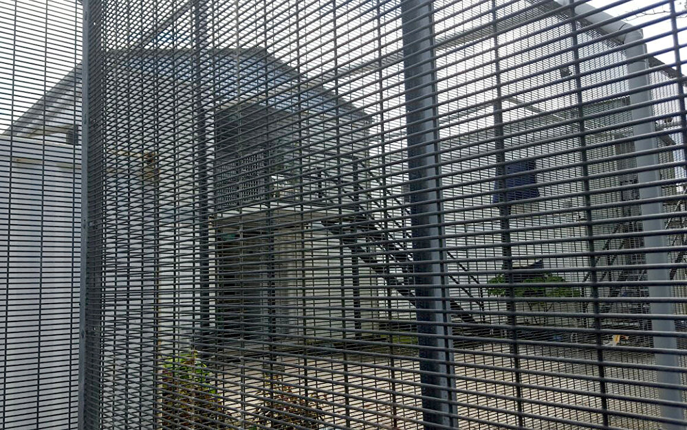 Security fences surround buildings inside the Manus Island detention centre in Papua New Guinea, February 11, 2017