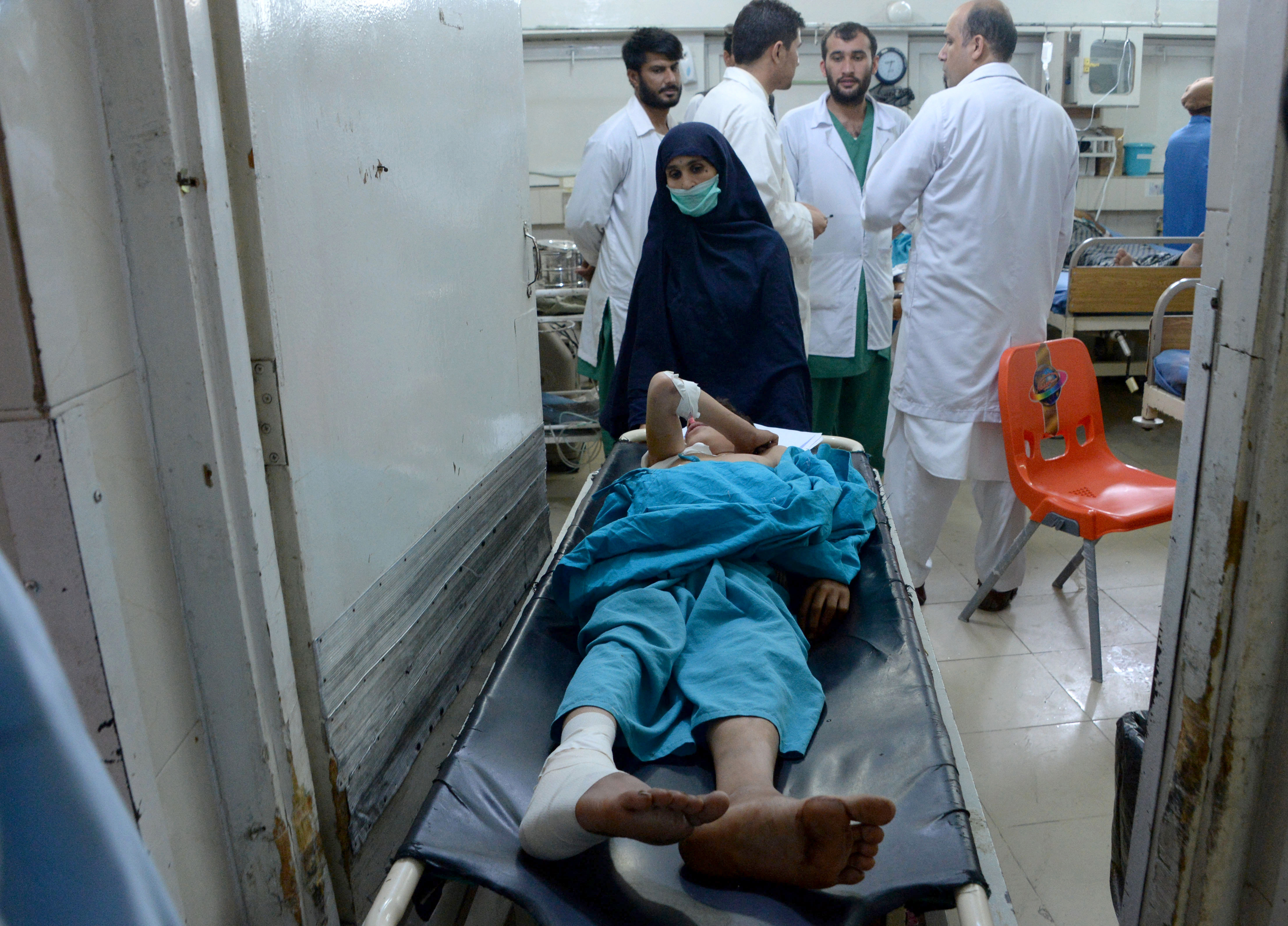 An injured Afghan youth receives treatment at a hospital following a suspected US drone airstrike in the Achin district of Nangarhar province. (File)