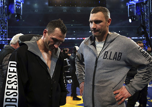 Wladimir Klitschko's with his brother Vitali, right, after losing to British boxer Anthony Joshua following their fight for Joshua's IBF and the vacant WBA Super World and IBO heavyweight titles, at Wembley Stadium, in London, Saturday, April 29, 2017