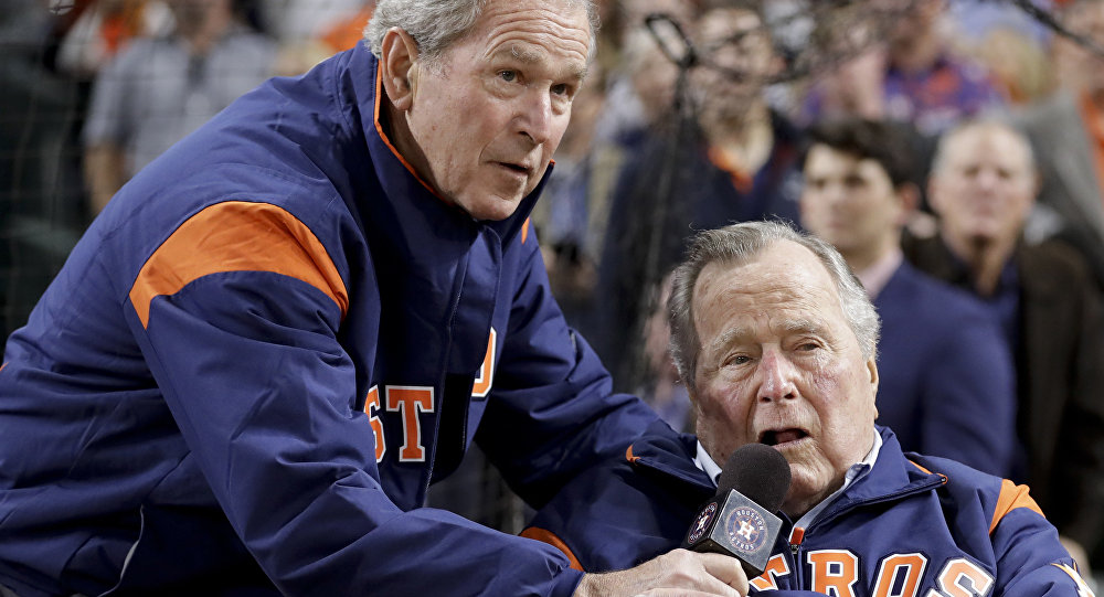 Former Presidents George H.W. Bush and George W. Bush make the play ball announcement before Game 5 of baseball's World Series against the Los Angeles Dodgers Sunday, Oct. 29, 2017, in Houston