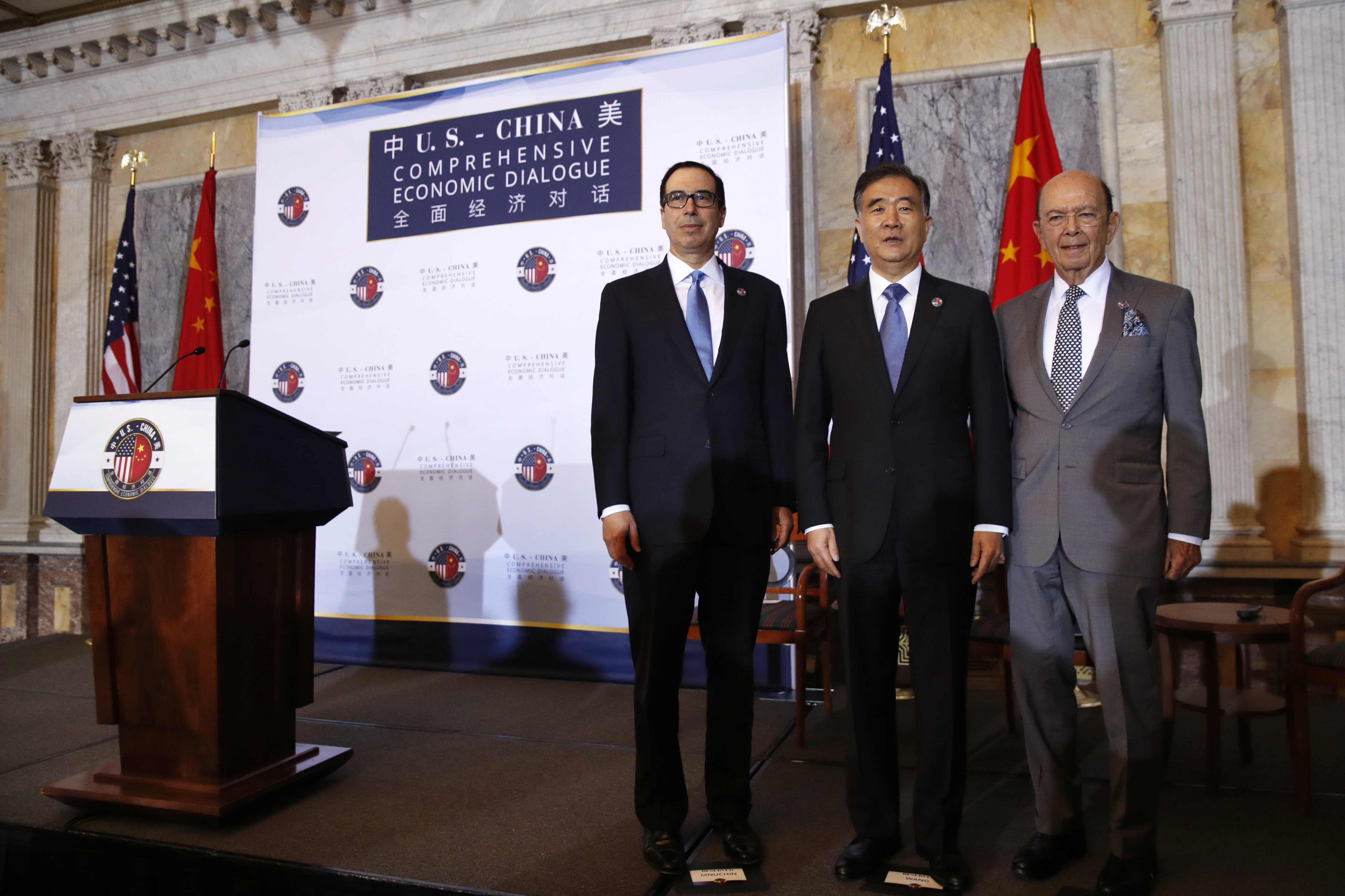 From left, Treasury Secretary Steve Mnuchin, Chinese Vice Premier Wang Yang, and Commerce Secretary Wilbur Ross pose for a group photograph before speaking at the opening of the U.S.-China Comprehensive Economic Dialogue, Wednesday, July 19, 2017, at the Treasury Department in Washington.