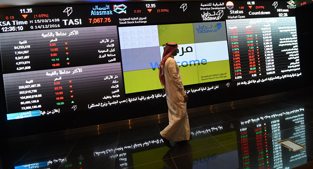 Saudi investor walking past the stock exchange monitors at the Saudi Stock Exchange, or Tadawul, in the capital Riyadh (File)