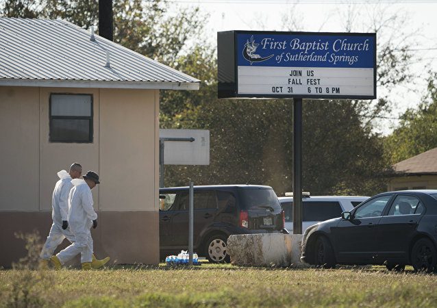 Members of the FBI walk next to the First Baptist Church of Sutherland Springs after a fatal shooting, Sunday, Nov. 5, 2017, in Sutherland Springs, Texas.