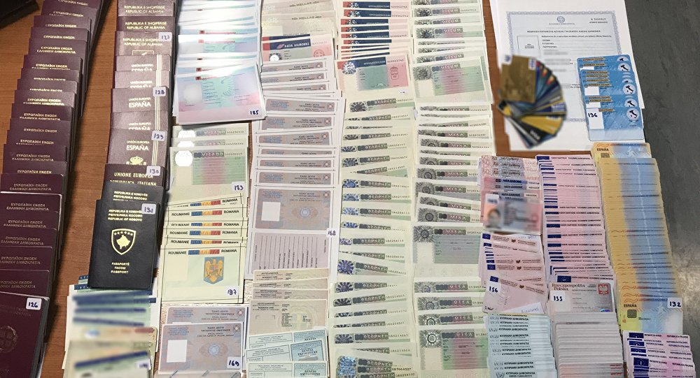 Some of the hundreds of fake passports and ID cards found in Athens