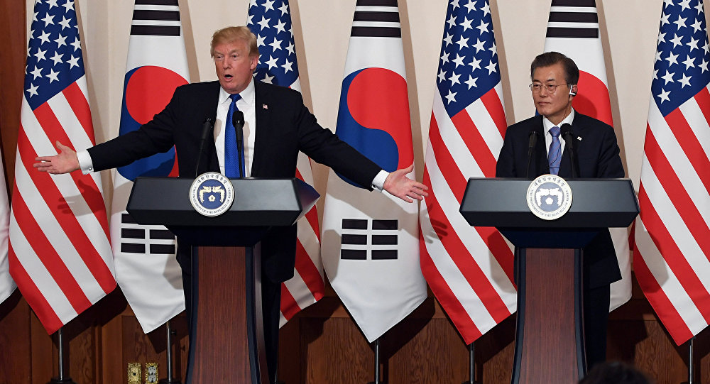 U.S. President Donald Trump gestures as he speaks during a joint press conference with South Korea's President Moon Jae-in at the presidential Blue House in Seoul, South Korea