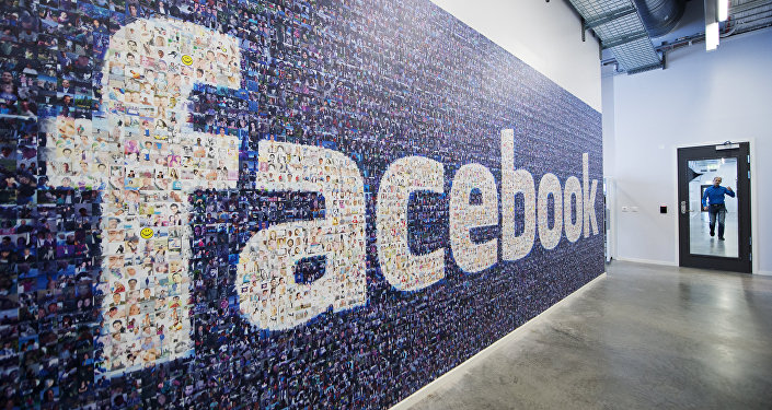 A big logo created from pictures of Facebook users worldwide is pictured in the company's Data Center, its first outside the US on November 7, 2013 in Lulea, in Swedish Lapland