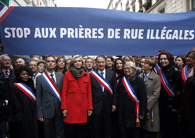 Clichy la Garenne's mayor Remi Muzueau, center right, and President of the Regional Council of the Ile-de-France region Valerie Pecresse, center left, demonstrate against Muslim street prayers, in the Paris suburb of Clichy la Garenne