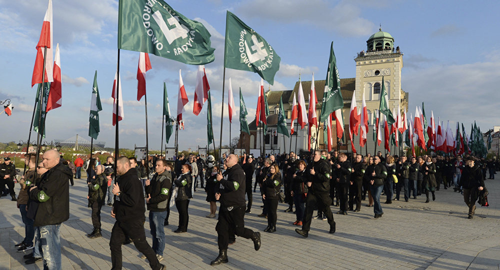 April 29, 2017 shows members of the far-right group, the National-Radical Camp, marking the 83rd anniversary of their organization, in Warsaw, Poland. Warsaw's Jewish community urged the country's most powerful politician, Jaroslaw Kaczynski, to denounce growing anti-Semitism, while other organizations on Thursday, Aug. 10, 2017 warned they witness a rise of extreme right-wing violence.