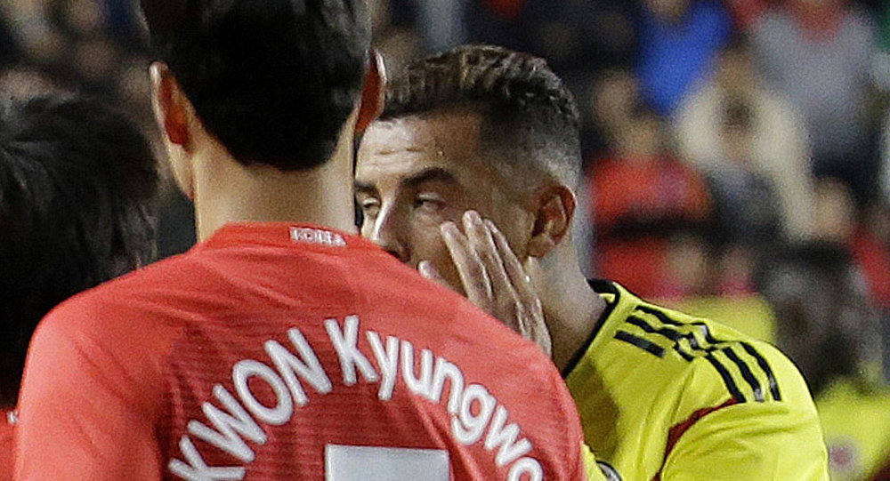 In this Friday, Nov. 10, 2017, photo, Colombia's Edwin Cardona, center, makes derogatory gesture during a friendly soccer match against South Korea at Suwon World Cup Stadium in Suwon, south of Seoul