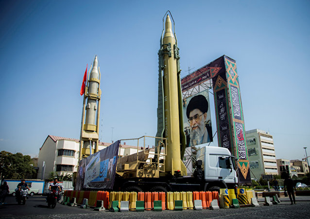 A display featuring missiles and a portrait of Iran's Supreme Leader Ayatollah Ali Khamenei is seen at Baharestan Square in Tehran, Iran September 27, 2017