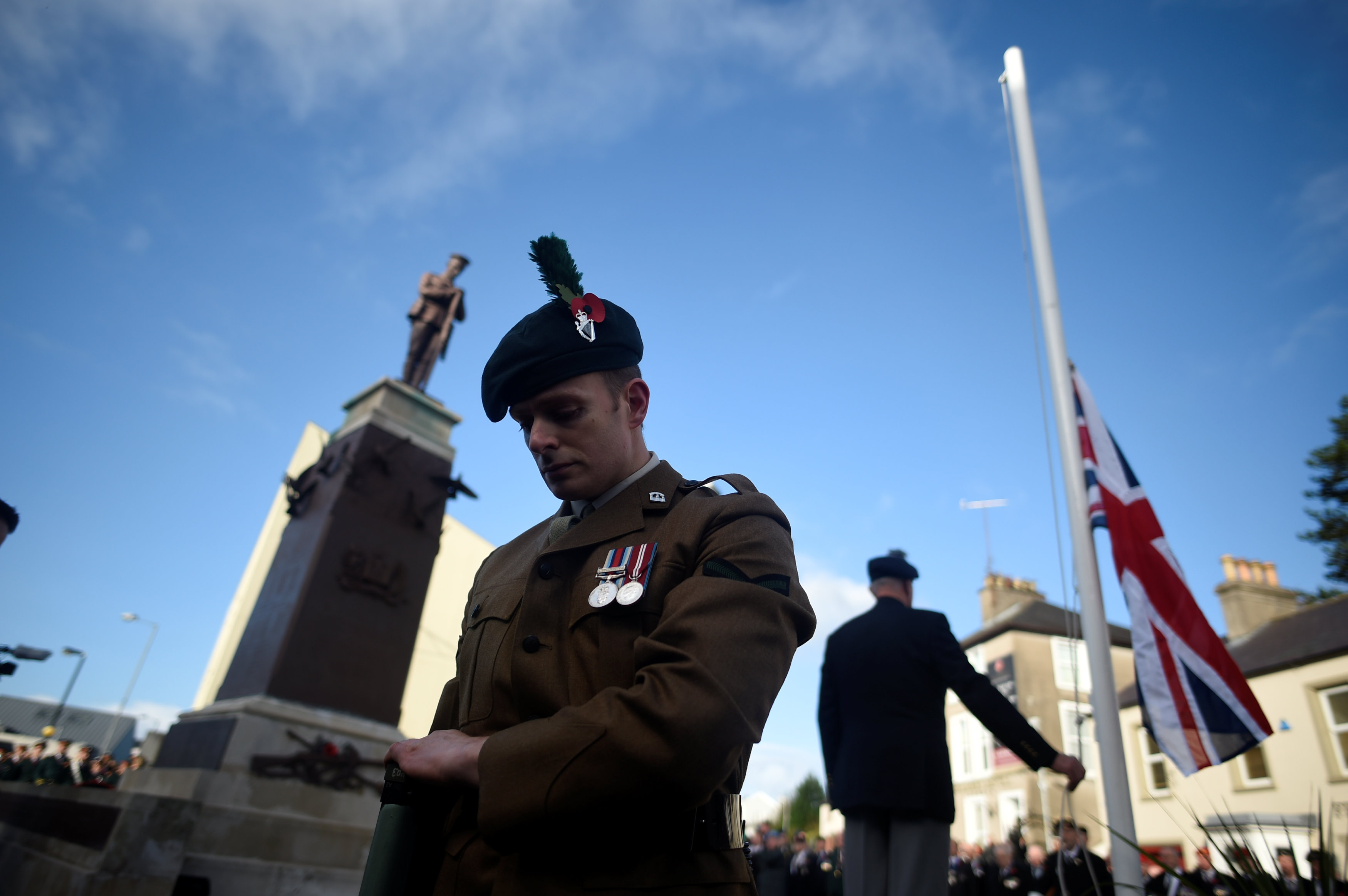 The Union flag is lowered to half mast during the Remembrance Sunday Cenotaph wreathe laying ceremony and commemoration of the 30th anniversary of the IRA Enniskillen bombing in Enniskillen, Northern Ireland, November 12, 2017