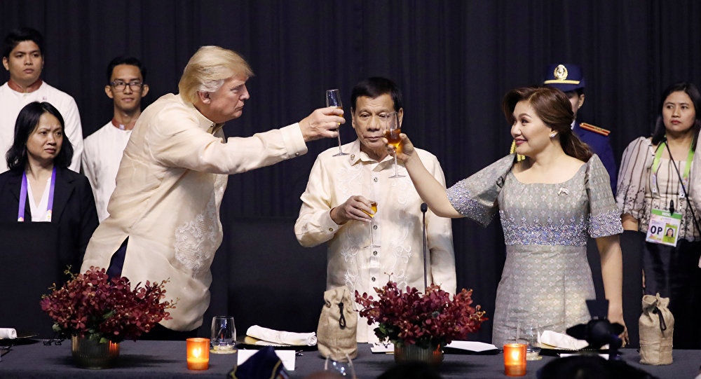 U.S. President Donald Trump toasts with Philippines President Rodrigo Duterte and Honeylet Avancena during the gala dinner marking ASEAN's 50th anniversary in Manila, Philippines November 12, 2017