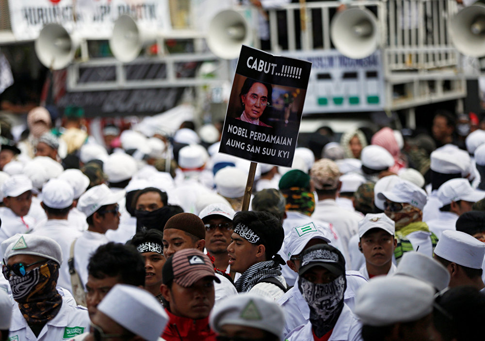 A man carries a placard during a protest led by Islamist groups near the Myanmar embassy protesting against the treatment of Rohingya Muslims, in Jakarta, Indonesia September 6, 2017. The placard reads Revoke Aung San Suu Kyi's Nobel Peace Prize!