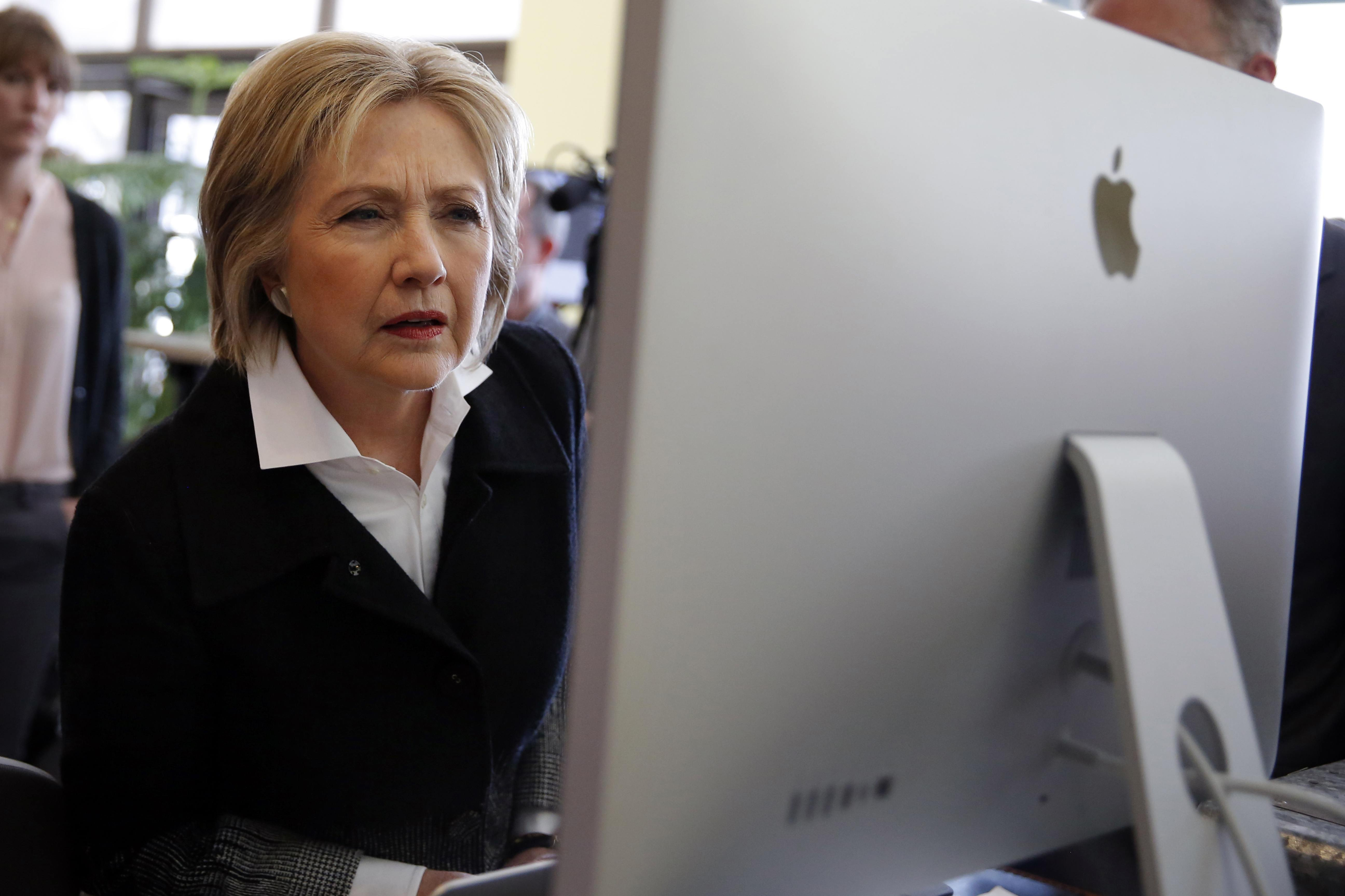 U.S. Democratic presidential candidate Hillary Clinton looks at a computer screen (File)