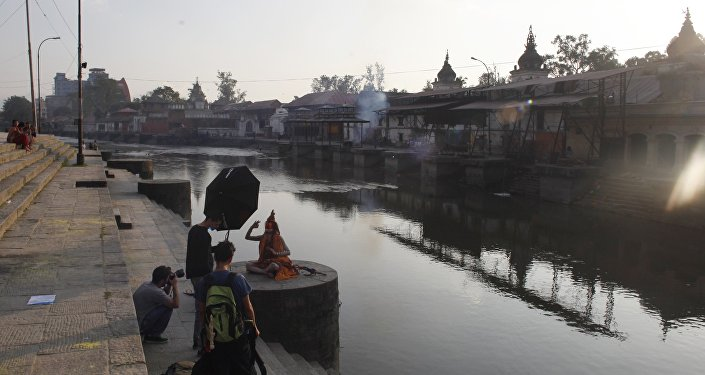 A Hindu holy man poses for a photographer on the bank of the Bagmati River near the Pashupatinath Hindu temple in Katmandu, Nepal. (File)