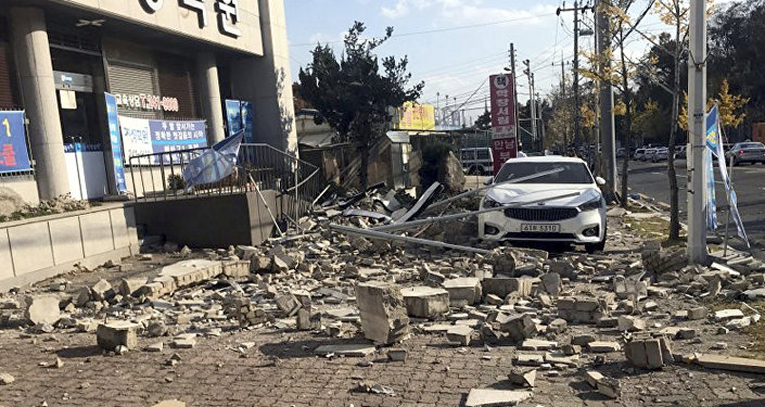 Debris from a collapsed wall is scattered in front of a shop after an earthquake in Pohang South Korea