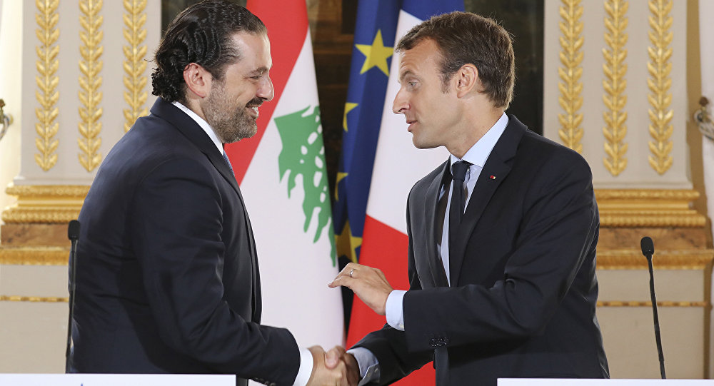 In this Sept. 1 2017 file photo, French President Emmanuel Macron, right, shakes hands with Lebanese Prime Minister Saad Hariri during a joint press conference at the Elysee Palace in Paris.