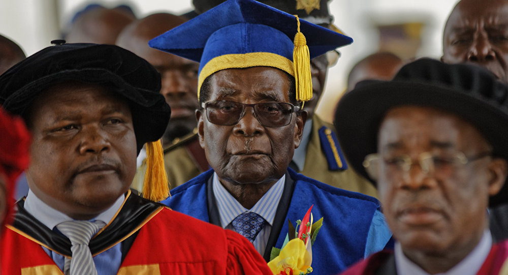 Zimbabwe's President Robert Mugabe, center, arrives to preside over a student graduation ceremony at Zimbabwe Open University on the outskirts of Harare, Zimbabwe Friday, Nov. 17, 2017