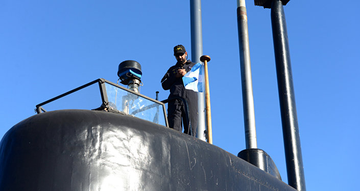 A crew member of the Argentine military submarine ARA San Juan stands on the vessel at the port of Buenos Aires, Argentina June 2, 2014