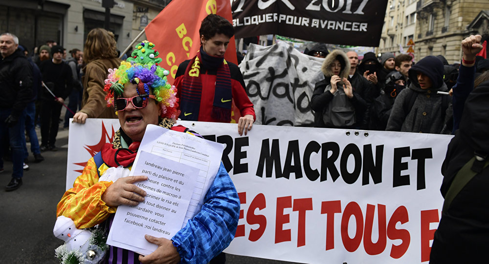 People take part in a march dubbed marche sur l'Elysée called by the Social Front against the Government's measures on assisted jobs, labour law reform and solidarity tax on wealth form (Impot de Solidarite sur la Fortune or ISF in French) reform, in Paris on November 18, 2017