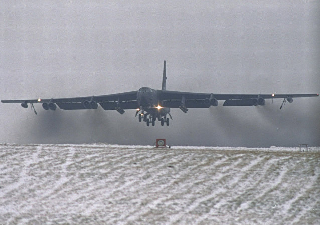 a giant nuclear-equipped USAF B-52 bomber lifts off from the snow covered RAF Fairford runway in Gloucestershire, England, en route to the Gulf