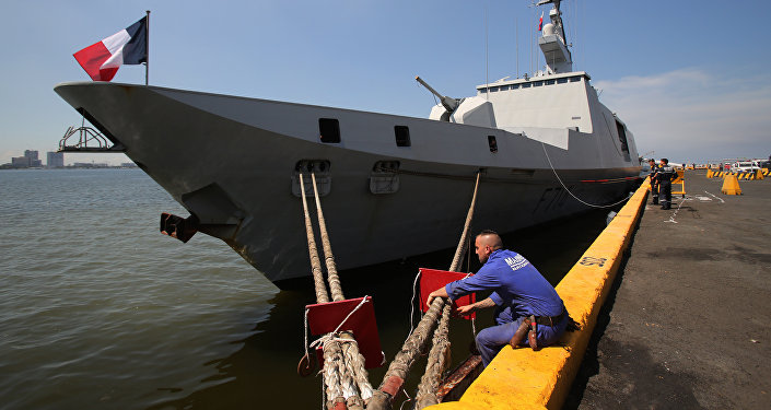 A member of the French Marine Nationale secures the Guepratte as it docks at a pier in Manila, Philippines on Wednesday, May 4, 2016