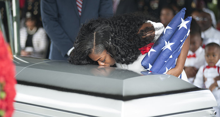 Myeshia Johnson kisses the casket of her husband Army Sgt. La David Johnson during his burial service for at the Memorial Gardens East cemetery on October 21, 2017 in Hollywood, Florida