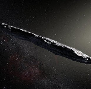 This artist's impression shows the first interstellar asteroid: 'Oumuamua. This unique object was discovered on 19 October 2017 by the Pan-STARRS 1 telescope in Hawai`i.