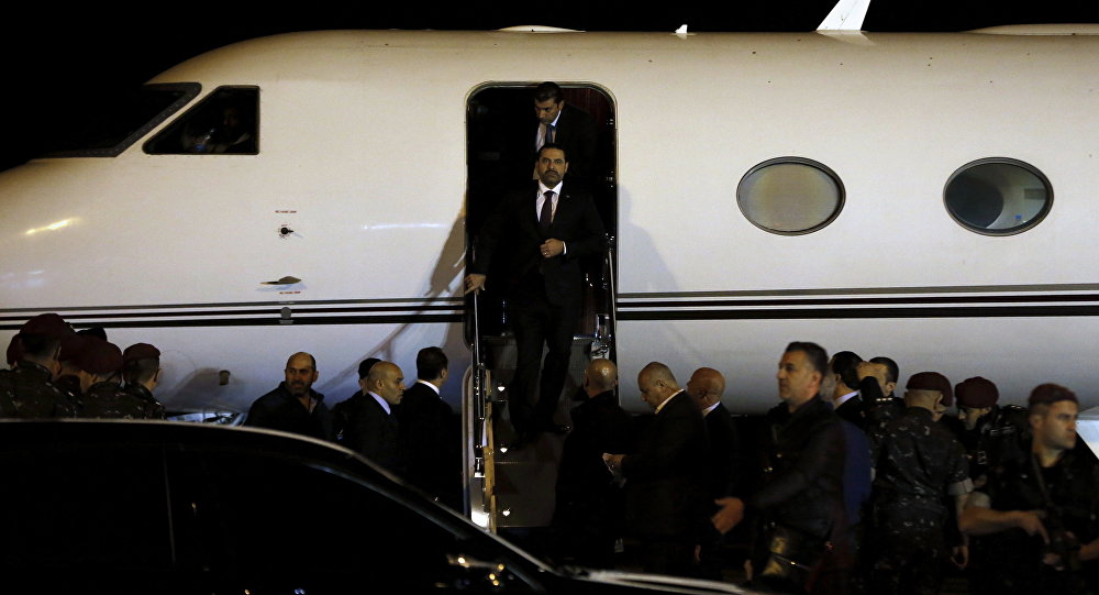 Lebanese Prime Minister Saad Hariri walks down the steps of an airplane upon arriving at the Rafik Hariri International Airport in Beirut, Lebanon, Tuesday, Nov. 21, 2017