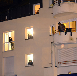Migrants look at their windows in a former retirement house (image used for illustration purpose)