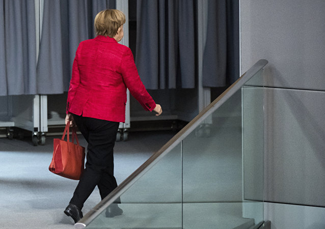 German Chancellor Angela Merkel leaves a plenary session of German parliament Bundestag in Berlin, Tuesday, Nov. 21, 2017