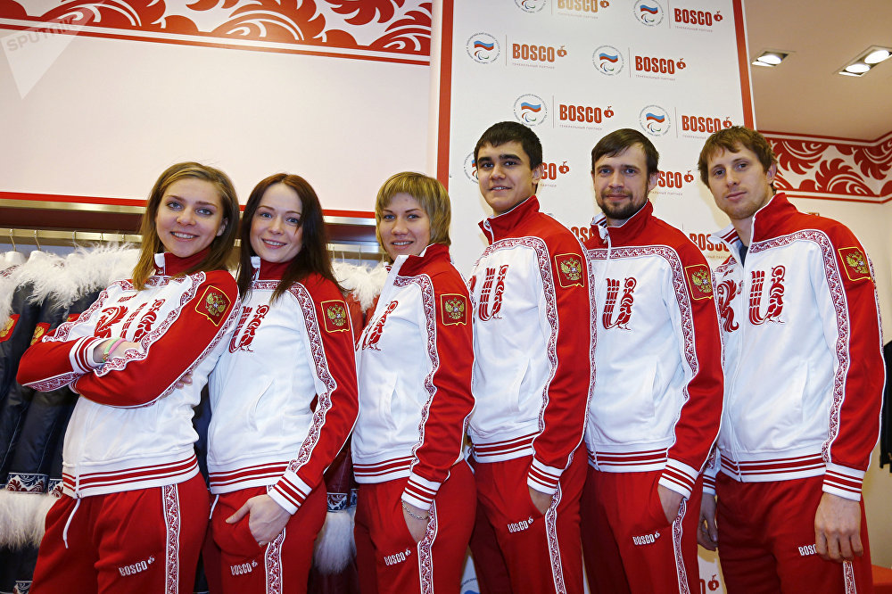 From left: members of the Russian national skeleton team Yelena Nikitina, Olga Potylitsyna, Maria Orlova, Nikita Tregubov, Alexander Tretyakov, and Sergei Chudinov demonstrate the team's Olympic uniform at Bosco store