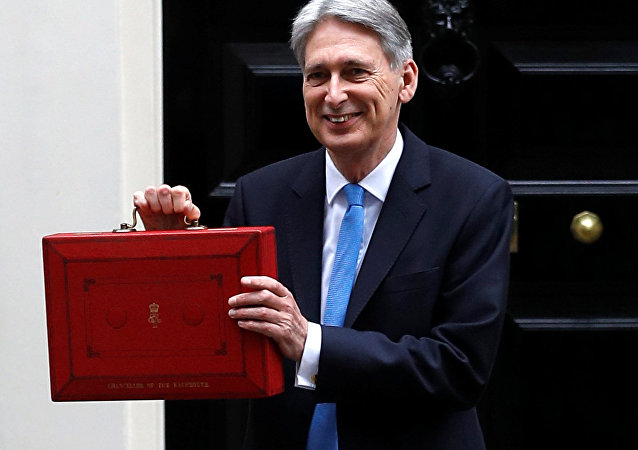Britain's Finance Secretary Philip Hammond leaves Downing Street on his way to deliver his budget statement to parliament, London, Britain, November 22, 2017.